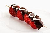 Strawberry skewer with chocolate icing