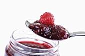 Raspberry jam on spoon