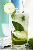 Adding soda water to Mojito