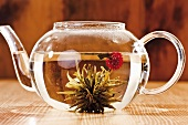 Tea flower in glass teapot