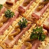 Schweinebauch (Cured Pork Belly) on Crackers with Brown Mustard