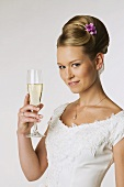 Young bride holding champagne glass, portrait