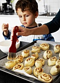Mother and son making cinnamon buns