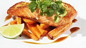 Fried salmon fillet on sweet potato chips (close-up)