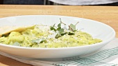 Serving herb ravioli onto plate