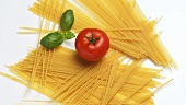Spaghetti with tomato and basil leaves