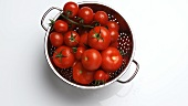 Tomatoes in a metal colander