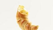 Hörnchen mit Honig