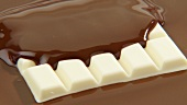 White chocolate on melted milk chocolate