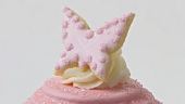 Pink cake with butterfly biscuit