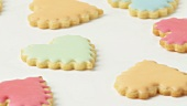 Heart-shaped biscuits with pastel-coloured icing