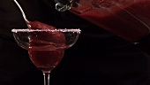 Pouring Strawberry Daiquiri into a cocktail glass