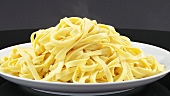 Steaming ribbon pasta on a plate