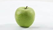 A rotating green apple