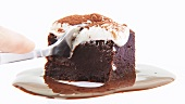 Brownie with cream and chocolate sauce