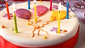 A birthday cake with burning candles