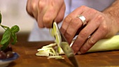 Cutting a leek into rings
