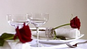 Laid table with red rose