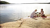 Two women picnicking on Blidö (Island, Stockholm Archipelago)