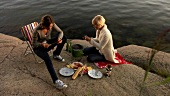 Two women barbecuing on Blidö (Island, Stockholm Archipelago)