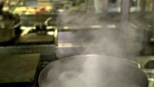 Steaming pan in a restaurant kitchen