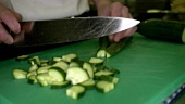 Chef chopping a cucumber