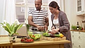 Couple preparing salad together