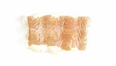 Salmon fillet turning into fish oil capsules