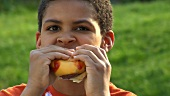 Boy eating a cheeseburger