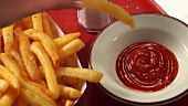 Dipping chips in ketchup