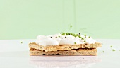 Soft cheese and chives on crispbread
