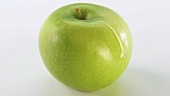 A Granny Smith apple with a drop