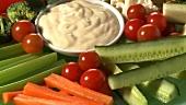 Platter of raw vegetables with dip