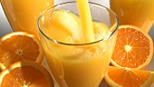 Pouring orange juice, apple juice, milk and tea