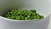 Cooked peas in a measuring jug