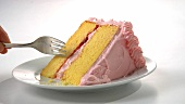 A piece of strawberry cream cake