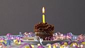 Chocolate cupcake with one candle