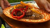 Grilled tuna steaks with pepper slices