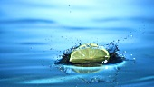 Lime slices falling into water