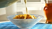 Pouring milk on cornflakes