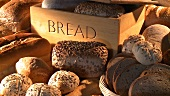 Bread bin and various types of bread and bread rolls