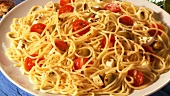 Spaghetti with tomatoes, mozzarella and olives