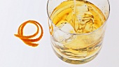 Pouring whisky into a glass containing ice cubes