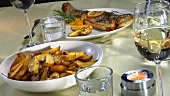 Stuffed trout with potato wedges
