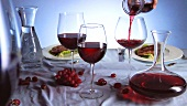 Various glasses of red wine on laid table