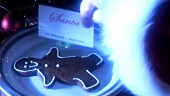 Santa's calling card and gingerbread man on plate