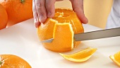 Peeling an orange with a knife