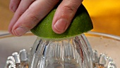 Squeezing a lime (close-up)