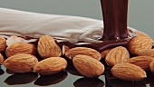 Pouring chocolate over almonds