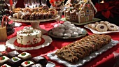 Gingerbread house and sweet baking on Christmas cake buffet